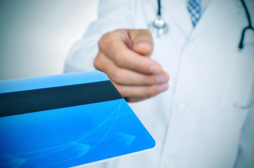 doctor accepting a credit card