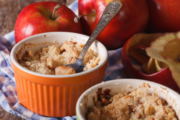 English crumble with apples close-up in the pot. Horizontal
