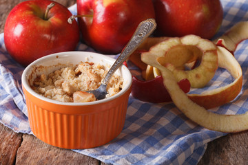 Delicious apple crumble close-up in a pot. Horizontal rustic