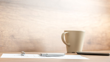 Fountain pen lying on office paperwork