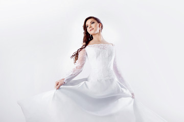 Dance bride in wedding dress, white background