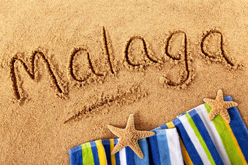 Malaga beach writing