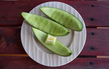 The three piece shell of melon on a plate