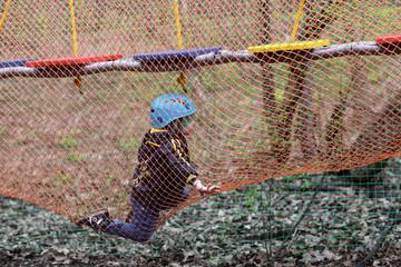 Boy climbing into a net