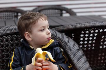 Child eating banana