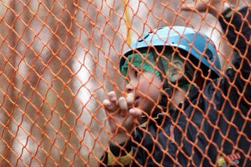 Child on a rope net