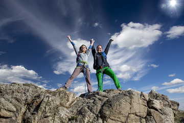 Group of two happy female climbers  celebrates victory