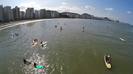 People surf and doing stand up in a Beach in Brazil
