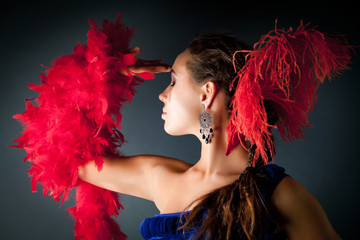 Young woman and red feathers