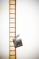 35mm movie filmstrip blank frames reel with clapper board