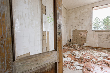Abandoned and ruined room with broken door