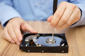 Engineer is recovering lost data from failed hard disk drive