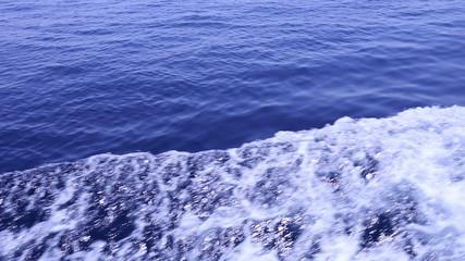 Dark blue water of the open ocean waves