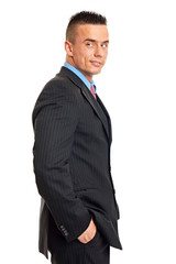 Thinking young businessman in suit on the white background