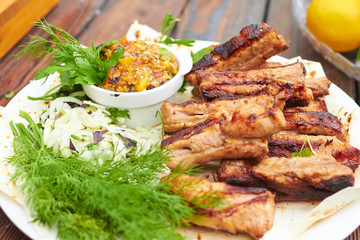 grilled ribs on fire with vegetables