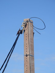 Close up of a cable being winched through a pulley