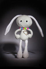 knitted gray rabbit with dimonds heart