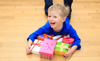 Happy child taking presents at family holiday