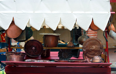 copper objects for kitchen and home for sale at flea market