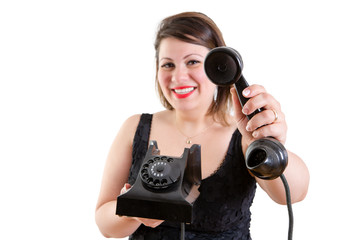 Friendly smiling woman holding out a telephone