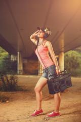 Beautiful hip hop woman enjoying the music