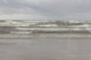 The storm in the Baltic Sea with raindrops on the glass