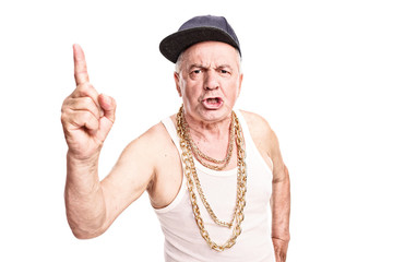 Angry senior with a hip-hop cap and a golden chain