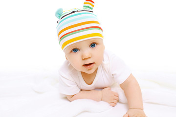 Closeup portrait of funny baby crawls in hat
