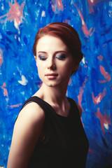 style redhead women in black dress