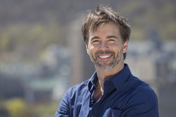 Portrait Of A Mature Active Man Smiling At The Camera