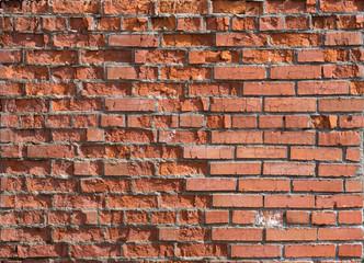 cracked worn red brick wall background