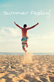 man jumping at beach - summer feeling