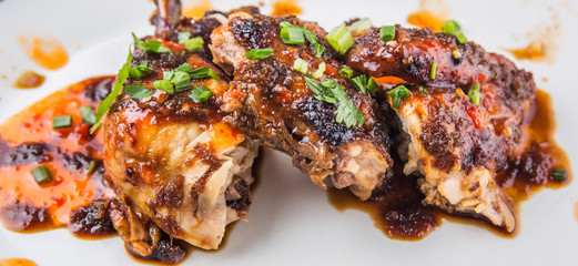Roasted chicken piece coated with soy sauce