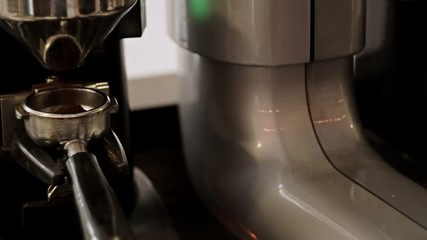 Tamping the grind coffee. Close-Up.