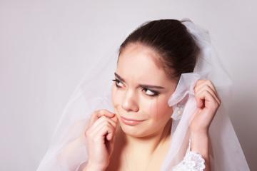 Portrait of a beautiful bride crying, closeup