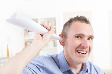 Man wearing deaf aid trying to hear something