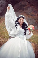 happy bride in autumn park