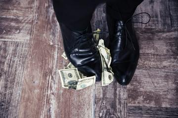 Businessman standing on the US dollar bills