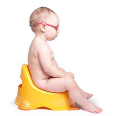 little baby with glasses sitting on the toilet