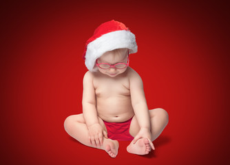 little baby with Santa hat and glasses