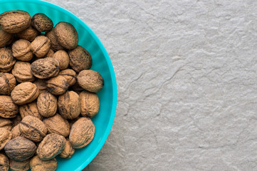 Pile of organic walnuts in a bowl, close up