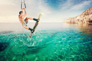 Wakeboarder making tricks on the sea. Wakeboarding. Water sports