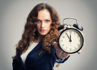 Girl showing alarm clock