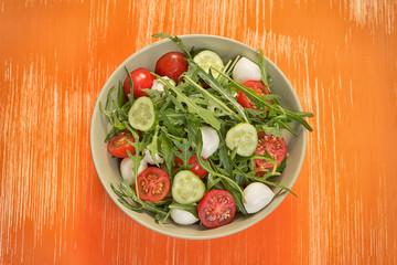 fresh vegetable salad with mozzarella and arugula