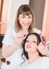 professional makeup making up her client