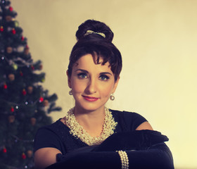 Face Brunette on the background of Christmas tree