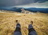 Legs of a man resting on mountains