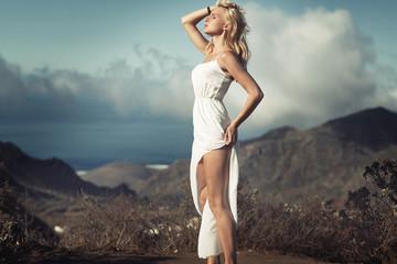 Sensual blond woman taking the sunbath