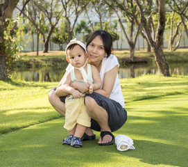 Asian mother hug baby