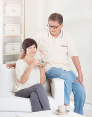 Asian senior couple relaxing at home
